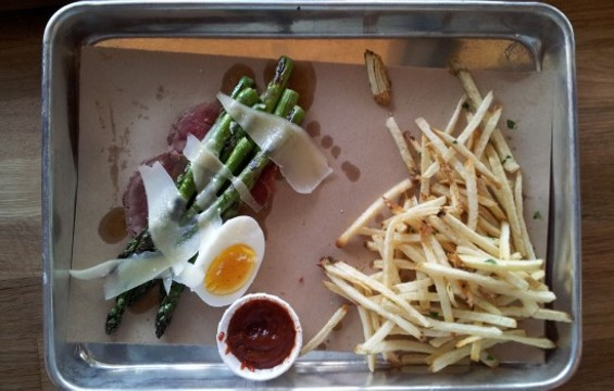 Grilled asparagus and beef fat french fries at Marrow. - PETE KANE