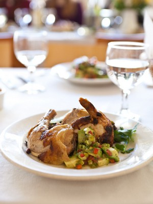 Grilled game hen with avocado-tomato salsa, from a class at Tante Marie's. - ALANNA HALE