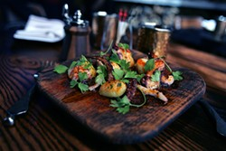 MIKE KOOZMIN - Grilled octopus is one of many hot tapas at Michael Chiarello's new Coqueta.