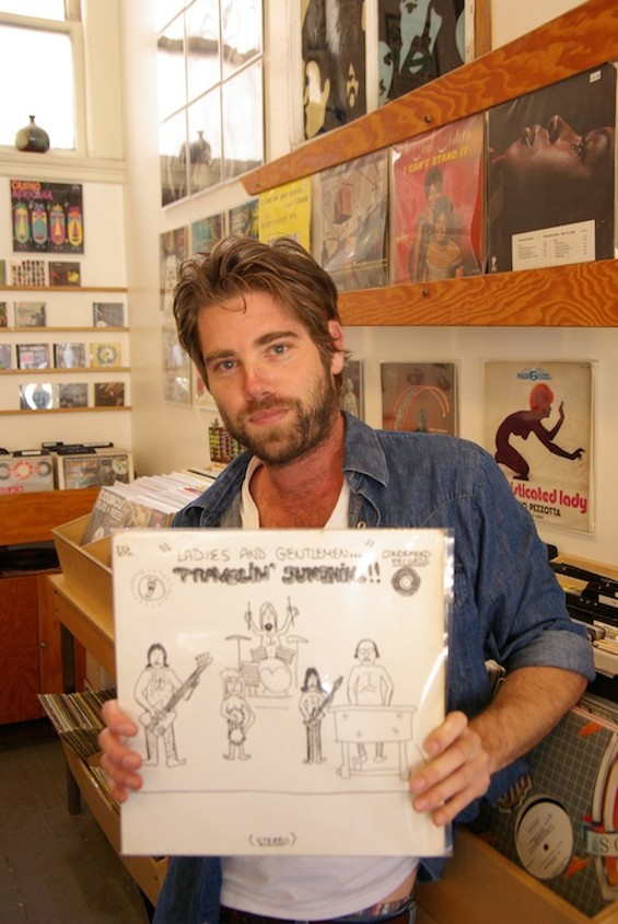 Groove Merchant owner Chris Veltri with a rare record. - IAN S. PORT