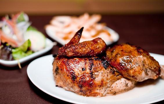 Half-chicken from Limón Rotisserie, $9.95. - ALBERT LAW/PORKBELLYSTUDIO.COM