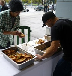 Hapa Ramen's Richie Nakano, right, deployed tobacco leaves for his crostini spread. - ALEX HOCHMAN