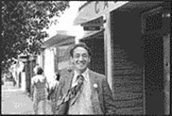 DANIEL  NICOLETTA - Harvey Milk in front of his camera - store, 1977.