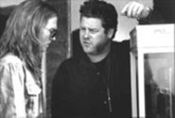 Having coke and a smile: Ted Demme, right, directs Johnny Depp (as George Jung) on the set of Blow.