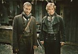 COURTESY OF DIMENSION FILMS - Heath Ledger, left, and Matt Damon star as - The Brothers Grimm.