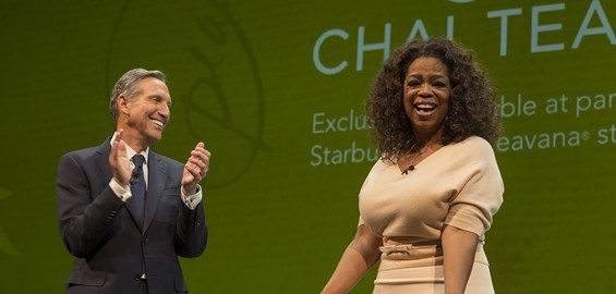 Howard Schultz and Oprah celebrate the announcement of her new chai tea line. - STARBUCKS NEWS