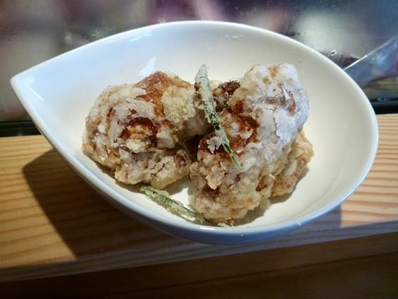 ICHI's yuzu chicken wings get a preliminary cooking sous vide. - ALEX HOCHMAN