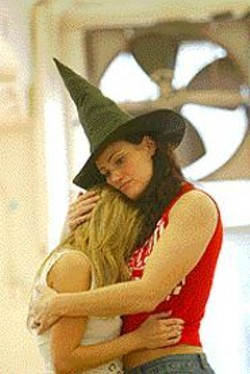 JOAN  MARCUS - Idina Menzel (Elphaba) and Kristin Chenoweth (Glinda) - play nice during rehearsals  of Wicked.