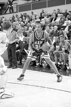 """PAUL  TRAPANI - In a game against Santa Clara, John Cox -- with his customary Afro braided into cornrows -- makes just three of 17 shots. After the game, he calls the hairstyle change """"bad luck"""" and reverts to the Afro."""