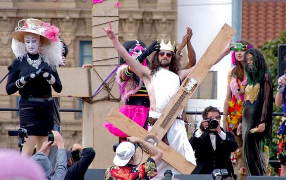 In an act of unprecedented sacrilege, Funky Jesus gives the devil horns as he's crowned Hunky Jesus 2012. - MICHAEL DEVIN