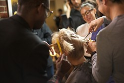 PHOTO COURTESY OF KOKI TANAKA - In Koki Tanaka's A Haircut by 9 Hairdressers at Once (Second Attempt), a woman volunteers to have her locks shorn.