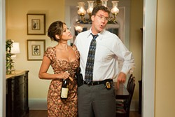 Insanely hot wife and just plain insane cop: Eva Mendes and Will Ferrell.