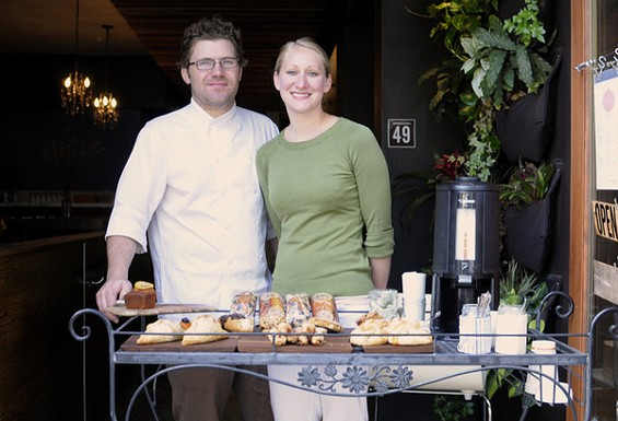 Jake and Shauna Des Voignes with Knead Patisserie's morning setup in front of Local Mission Eatery. - CHRIS MACARTHUR/SF WEEKLY