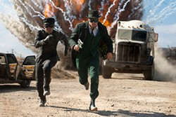 Jay Chou and Seth Rogen flee a bombastic action sequence.