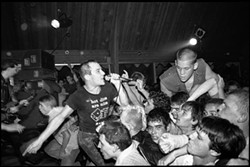 Jello Biafra of S.F. punkers the Dead Kennedys goes wild at an early show in this never-before-published image by punk/skate photographer Glen E. Friedman.