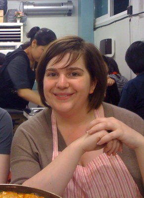 Jennifer Flinn at a ramen-rice cake shop in Seoul. Note: She does not normally wear a bib. - JONATHAN KAUFFMAN