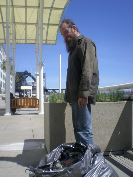 Jim McQuown looks forward to snapping up beer cans and empty bottles near AT&T Park - JOE ESKENAZI