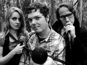 Joel Streeter (center) with Megan Slankard(L) and Brad Brooks (R)