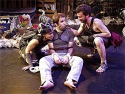 """MELPOMENE KATAKALOS - John (Cole Alexander Smith, center) is flanked by two Junk City """"Finders"""" (Rami Margron and Michael Moran)."""
