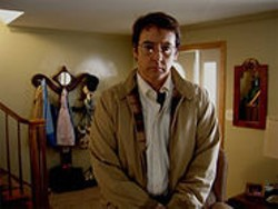 John Cusack as Stanley Phillips in James C. Strouse's Grace Is Gone.