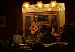 "RICK TREUR - Jon Troast performs in a fan's home during his ""100 House Concerts in 100 Days"" tour."