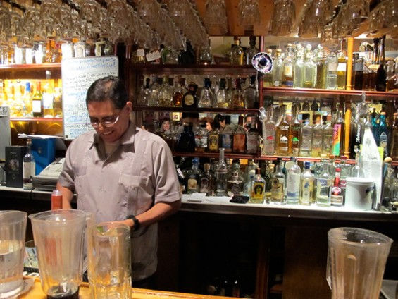 Julio Bermejo behind the bar at Tommy's. - LOU BUSTAMANTE