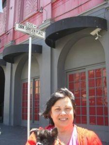 Kathy Peck stands at Dirk Dirksen Place