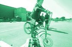 PAUL  TRAPANI - Keenan Cruz masters the Twirl and Hurl at the Heavy Pedal Cyclecide Bike Rodeo.