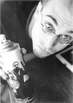 AKIM  AGINSKY - Kevin Wortis, holding a Dave Sardy-emblazoned spray can.