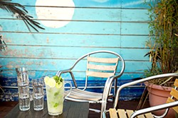 MOLLY DE COUDREAUX - Kick back with a pitcher of margaritas on the patio at Virgil's.