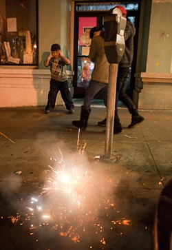 JOSEPH SCHELL - Kids with firecrackers in Chinatown on Feb. 3, Chinese New Year's Day.