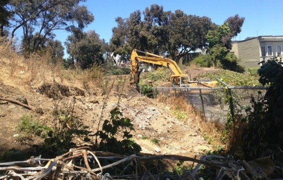 Large machinery moved into the former Hayes Valley Farm this afternoon. - ANNA ROTH