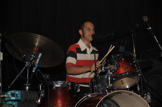 curumin_on_the_drum_kit.jpg