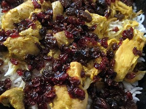 Lavash's zereshk polo comes with basmati rice studded with barberries and raisins, a bit of edible Persian bling. - CARINA OST