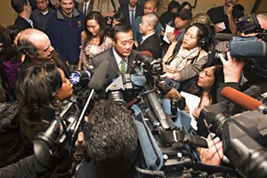 Leland Yee and a throng of reporters