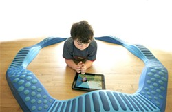 KELLY NICOLAISEN - Leo has plenty of toys, including this circular balance beam, but nothing tops the iPad.
