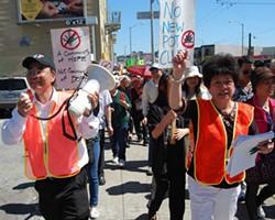 Leon Chow (left) leads the way against medical marijuana dispensaries