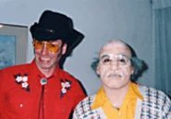 Leon with Simpson in his paleface get-up.