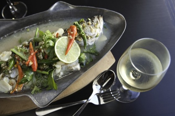Lers Ros' steamed sea bass with chile and lime. - KIMBERLY SANDIE