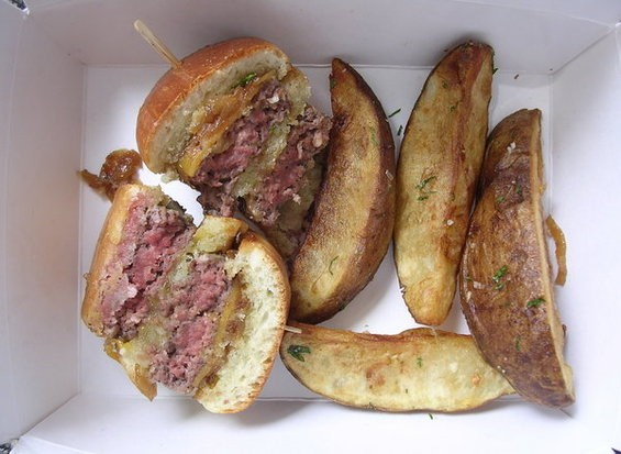 Little burger with Tillamook cheddar, caramelized onions, and crispy wedged potatoes ($6). - JOHN BIRDSALL