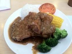 Little Garden's black pepper pork chop with rice, $8.95. - JONATHAN KAUFFMAN