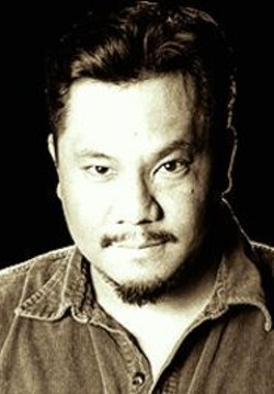 BJ  FORMENTO - Local Boy Makes Good: Comedian Rex Navarrete - performs to sellout crowds in his native Manila.