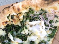 JOHN BIRDSALL - Locanda da Eva's wilted kale pizza with house-cured lardo and smoked provolone.