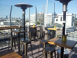 PETE KANE - Lolinda's new expansive patio has an  urban view.