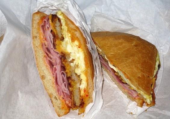 Lou's breakfast sandwich puts the hash browns between ciabatta halves. - LUIS CHONG