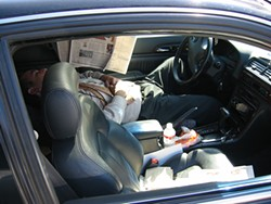 COURTESY OF THE LAW OFFICES OF ERIC M. SAFIRE - Lu says he snapped this photo of his supervisor, Alfredo Bustamante, sleeping in his car while on the job. Lu claims he was fired as retaliation.