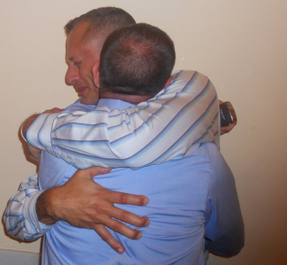 Luis Juarbe grows emotional as he embraces his partner, Mike Reardon. The couple's reaction came after it was announced the stay had been lifted on Judge Vaughn Walker's Prop. 8 ruling. - JOE ESKENAZI