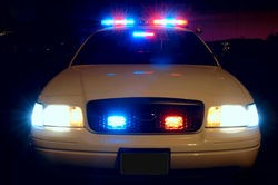 800px_police_car_with_emergency_lights_on_thumb_250x166.jpg