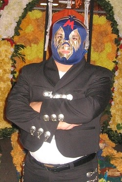 Mando Rayo: The mask helps hide the salsa burns.
