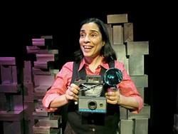 Marga Gomez snaps moments in lesbian history in The Lovebirds.